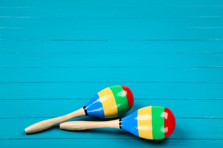 Mexican maracas on blue wooden table Stock Photo