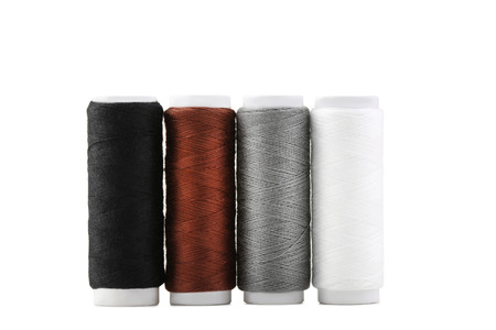 Colourful thread spools isolated on a white background