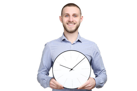 Portrait of young man with round clock on white hbackground