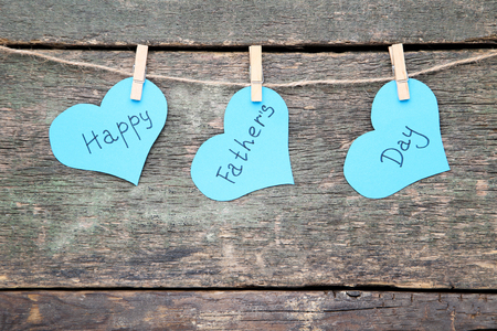 Text Happy Fathers Day hanging on wooden background Archivio Fotografico