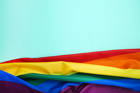 Rainbow flag on blue background Stock Photo