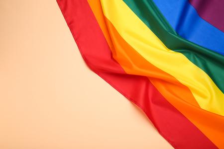 Rainbow flag on beige background Stock Photo