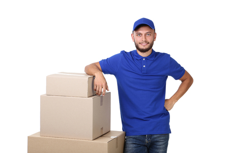 Delivery man with cardboard boxes isolated on white background