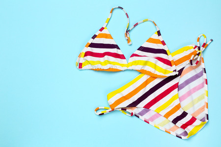 Fashion striped swimsuit on blue background