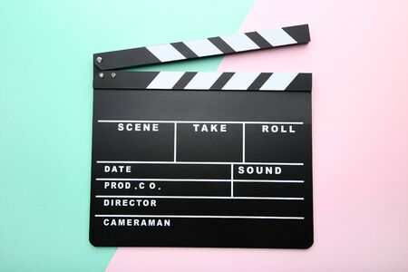 Clapper board on colorful background