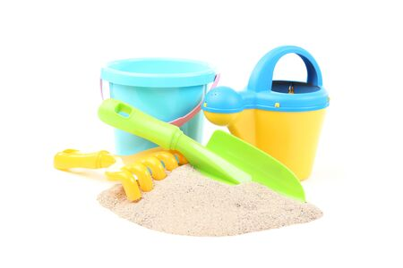 Plastic toys with beach sand isolated on white background