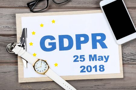 General Data Protection Regulation, GDPR. Clipboard with paper, wrist watch and smartphone Stock Photo