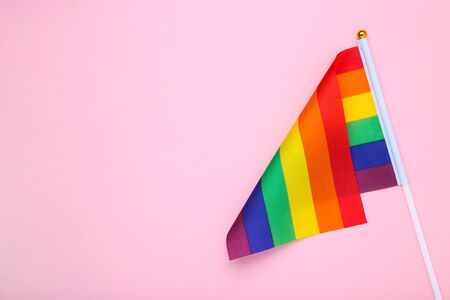 Rainbow flag on pink background Archivio Fotografico