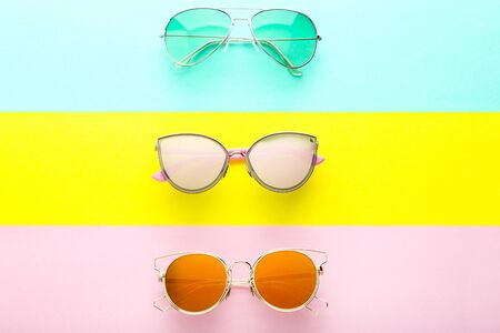 Modern sunglasses on colorful background Stock Photo