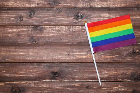 Rainbow flag on brown wooden table