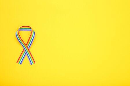 Rainbow ribbon on yellow background Stock fotó