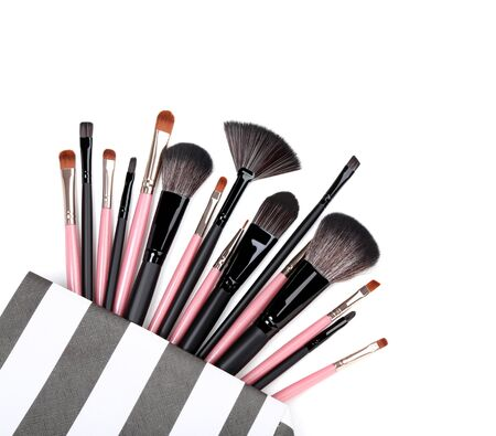 Makeup brushes in bag isolated on white background Imagens