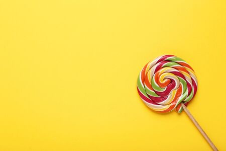 Colorful lollipop on yellow background Banque d'images