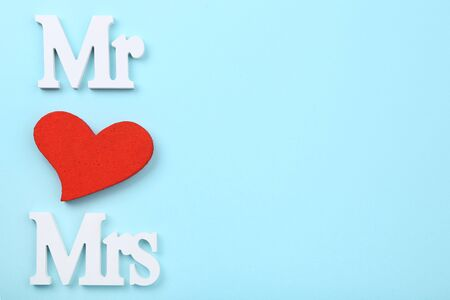 White letters Mr and Mrs with red heart on blue background