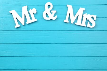 White letters Mr and Mrs on blue wooden table Stock fotó