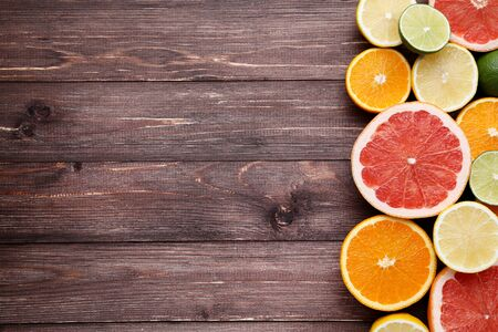 Citrus fruits on brown wooden table Stockfoto