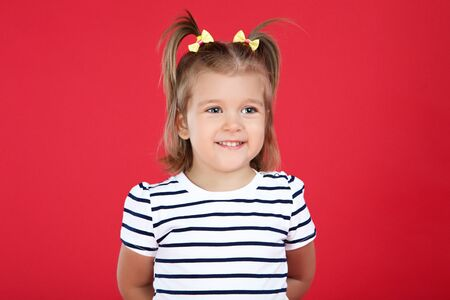 Cute little girl on red background