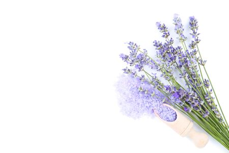 Lavender flowers and spa salt on white background