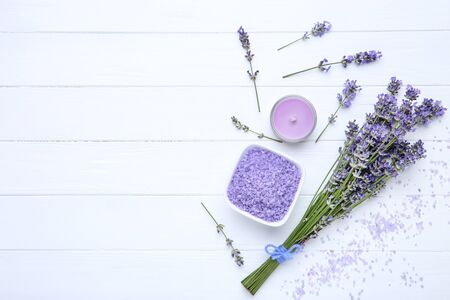 Lavender flowers with spa salt and candle on white wooden table 写真素材