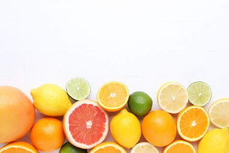 Citrus fruits on white wooden table Stock Photo