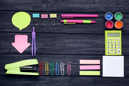 School supplies on black wooden table