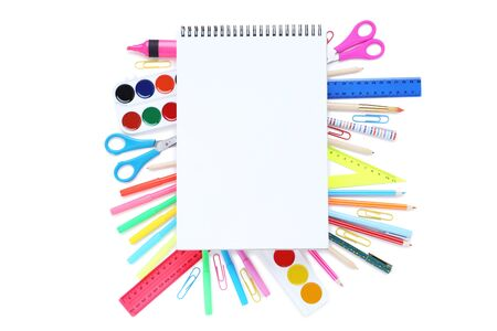 Different school supplies with blank sheet of paper on white Stock fotó