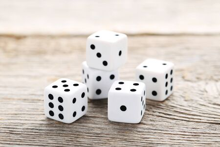 White dice on grey wooden table