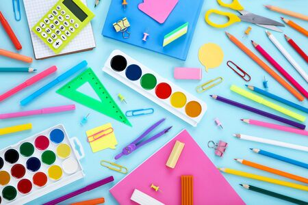 Different school supplies on blue Stock fotó