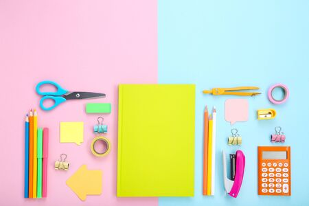 Different school supplies on colorful Stock fotó