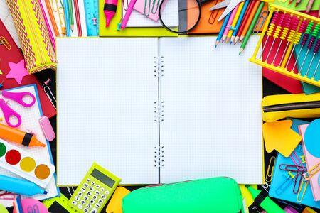 Different school supplies with blank sheet of paper
