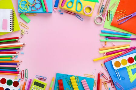 Different school supplies on pink