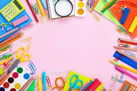 Different school supplies on pink