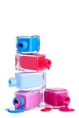 Nail polish splatters and bottles on white