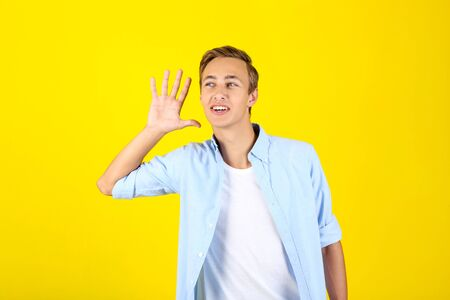 Portrait of young man in shirt on yellow background Stok Fotoğraf