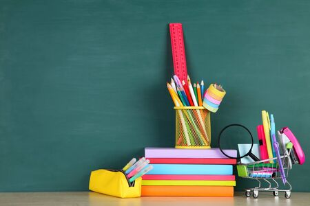 School supplies on green background