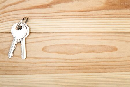 House keys on brown wooden table