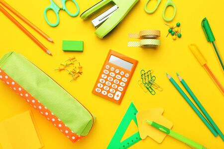 School supplies on yellow background. Minimalism concept