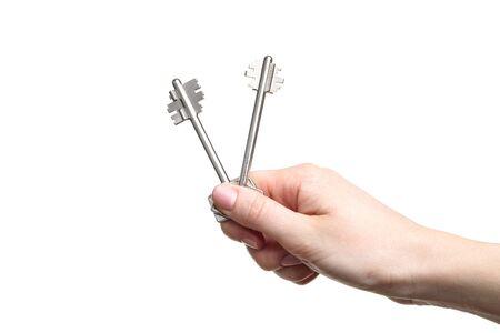 Female hand holding house keys on white background