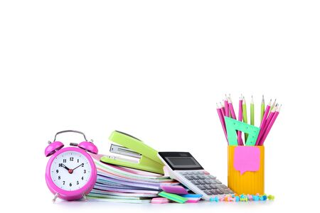 School supplies with pink alarm clock on white background 写真素材