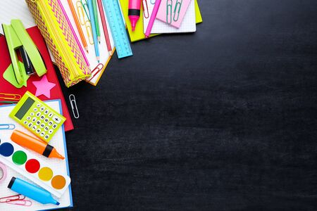 Different school supplies on blackboard 写真素材