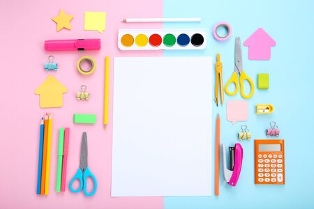 School supplies with blank sheet of paper on colorful background 写真素材