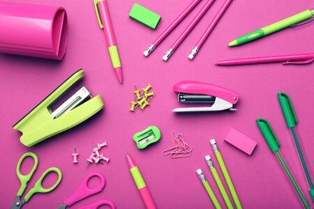 School supplies on pink background. Minimalism concept