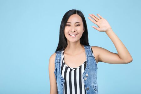 Beautiful young woman on blue background