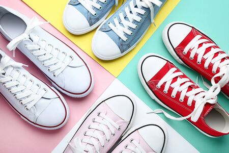 Different colorful sneakers on colorful background