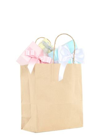 Shopping bag with gift boxes isolated on white background