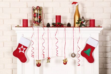 White decorated fireplace on brick wall background