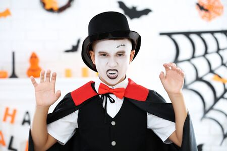 Young boy in halloween costume showing teeth