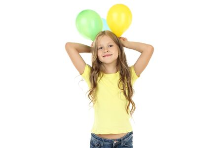 Pretty little girl with rubber balloons on white background Stok Fotoğraf