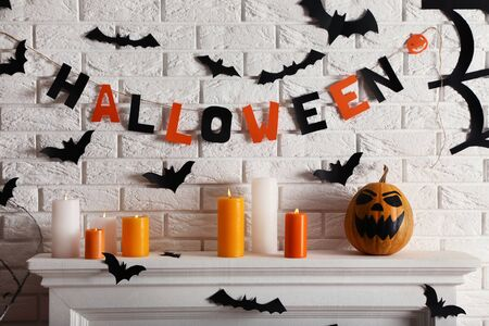 Halloween decorations on white fireplace