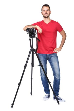 Young photographer with camera on tripod isolated on white background